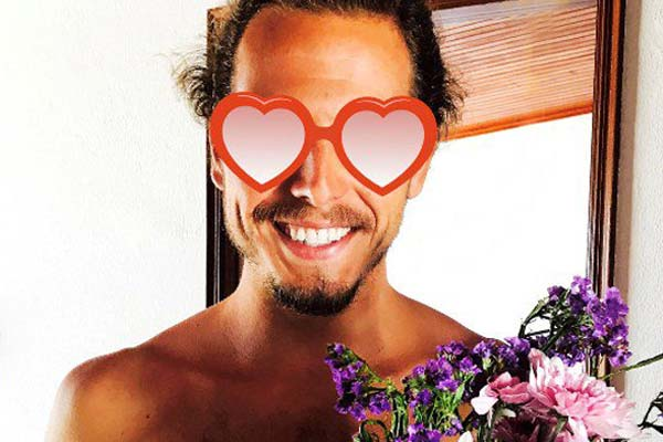 man with flowers and heart glasses